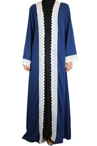 woman wearing an abaya in blue embellished with white lace sleeves