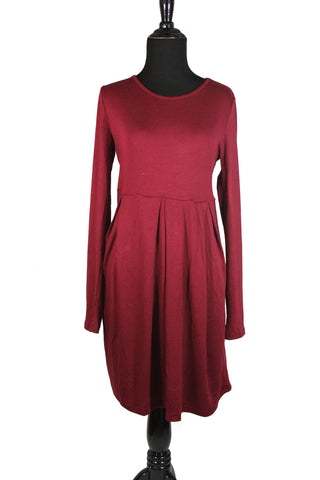 maroon long sleeved midi top with an aline and pleats