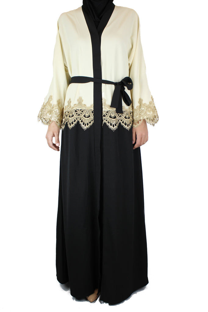 black and creme two toned abaya with gold trim and waist tie