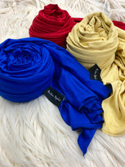 three jersey hijabs in primary colors red blue and yellow