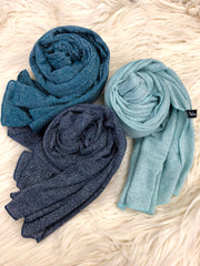 navy, turquoise, and teal jersey shimmer hijabs on fur rug