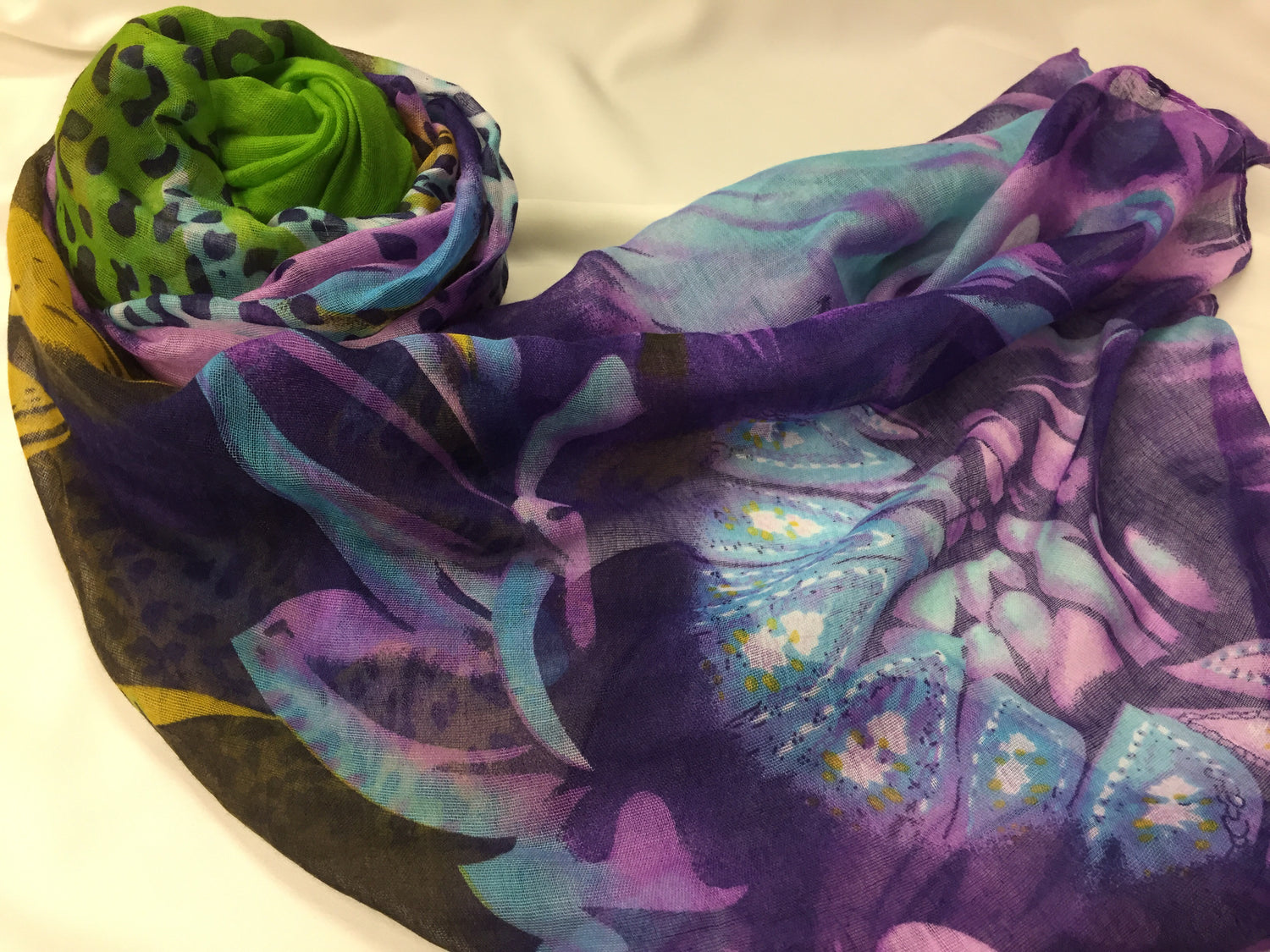 purple and green print hijab with cheetah print and floral