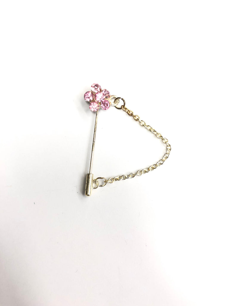 silver clasp pin with light pink floral jewel and a chain