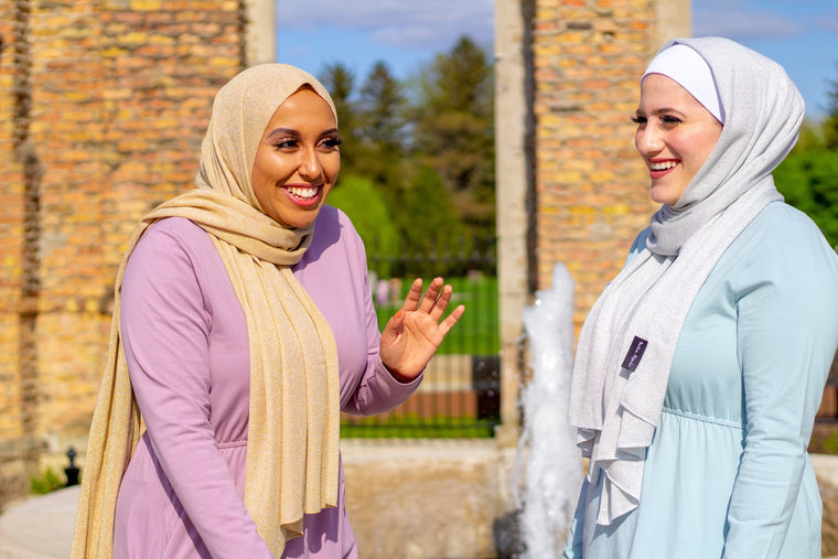 two muslim women wearing long sleeved maxi dresses and sparkly jersey hijabs