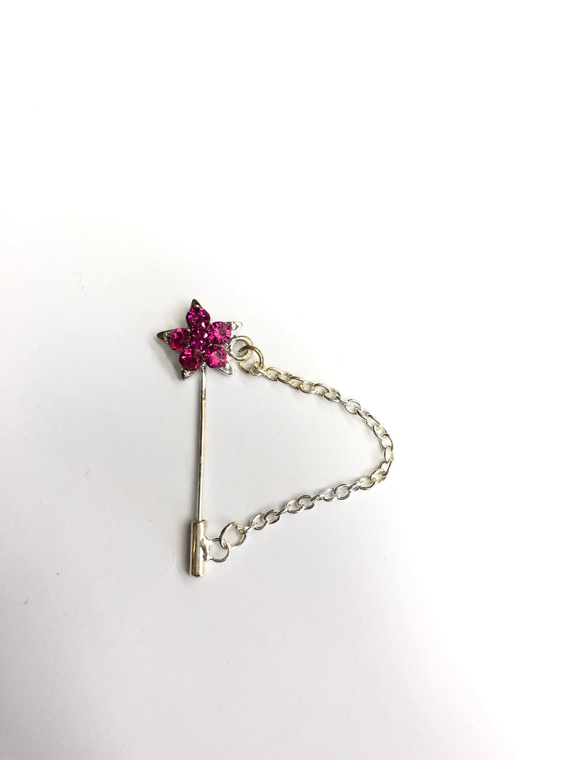 silver clasp pin with hot pink star jewel and a chain