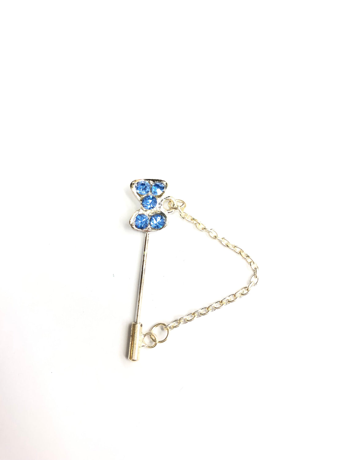 silver clasp pin with blue bow jewel and a chain