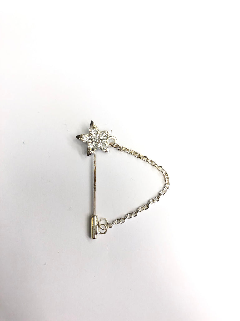 star shaped hijab pin with white jewels and a clasp at the end