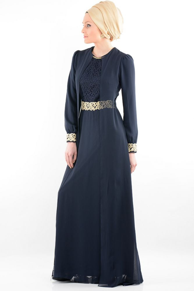 turkish woman wearing a gold hijab an elegant navy long sleeve maxi dress with gold embellishments