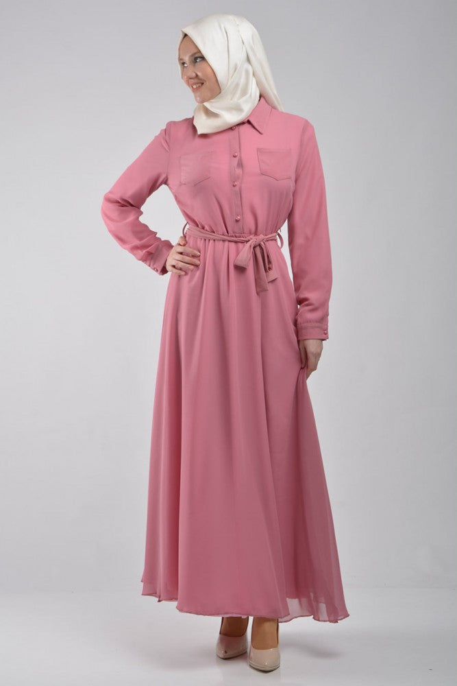 long sleeve maxi dress in pink with pockets and a waist tie