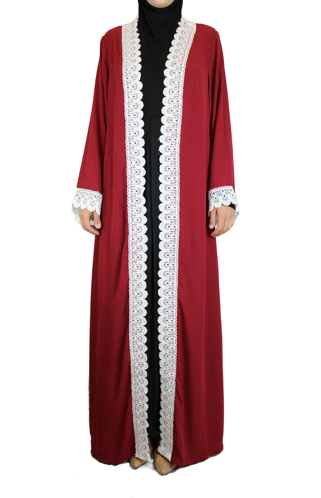 woman wearing an abaya in red embellished with white lace sleeves