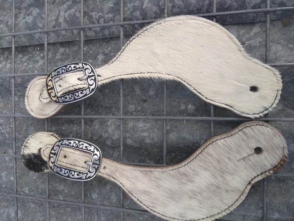 White cow hide spur straps