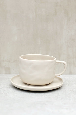 White Stoneware Teacup and Saucer