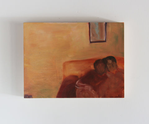Couple on orange couch