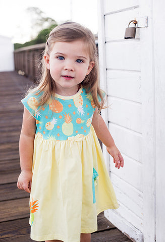 Girl's yellow dress with contrast pigquet trim