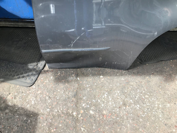 BMW X5 2009 passenger side rear bumper needs slight repair and respray