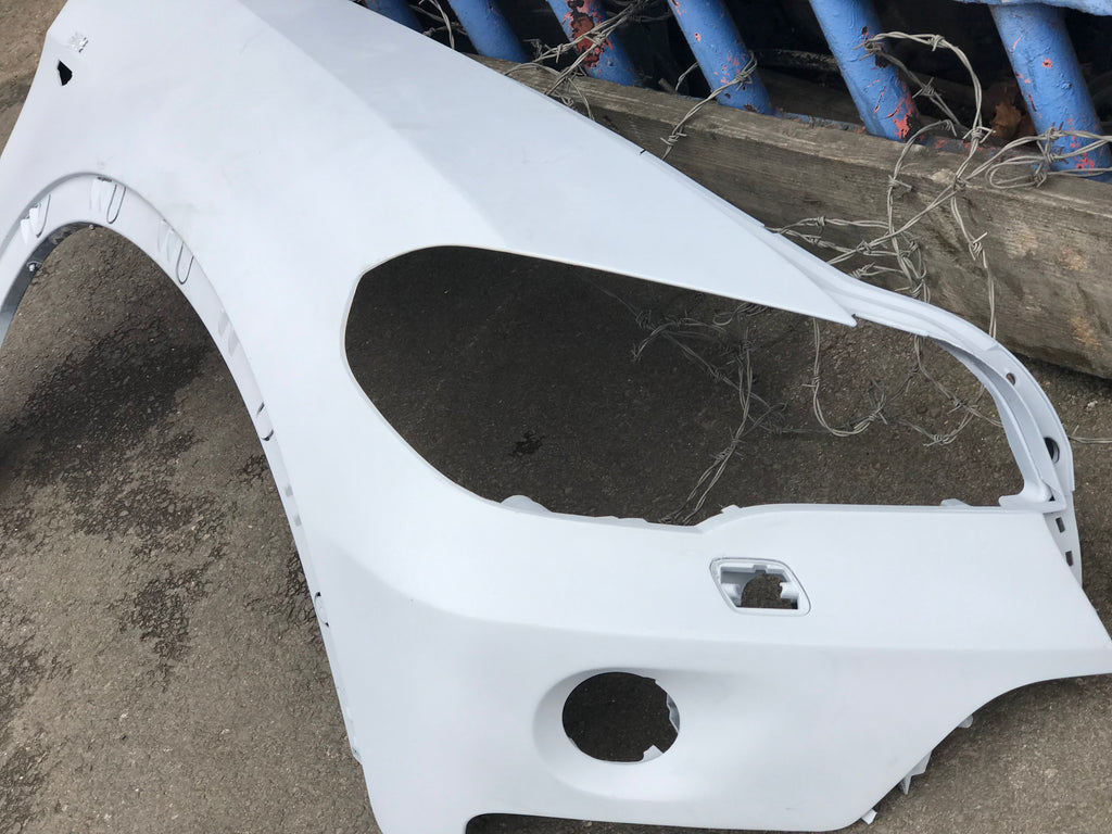 Bmw X5 E70 2013 driver side wing has fog light holes has been primed. Ready for spray