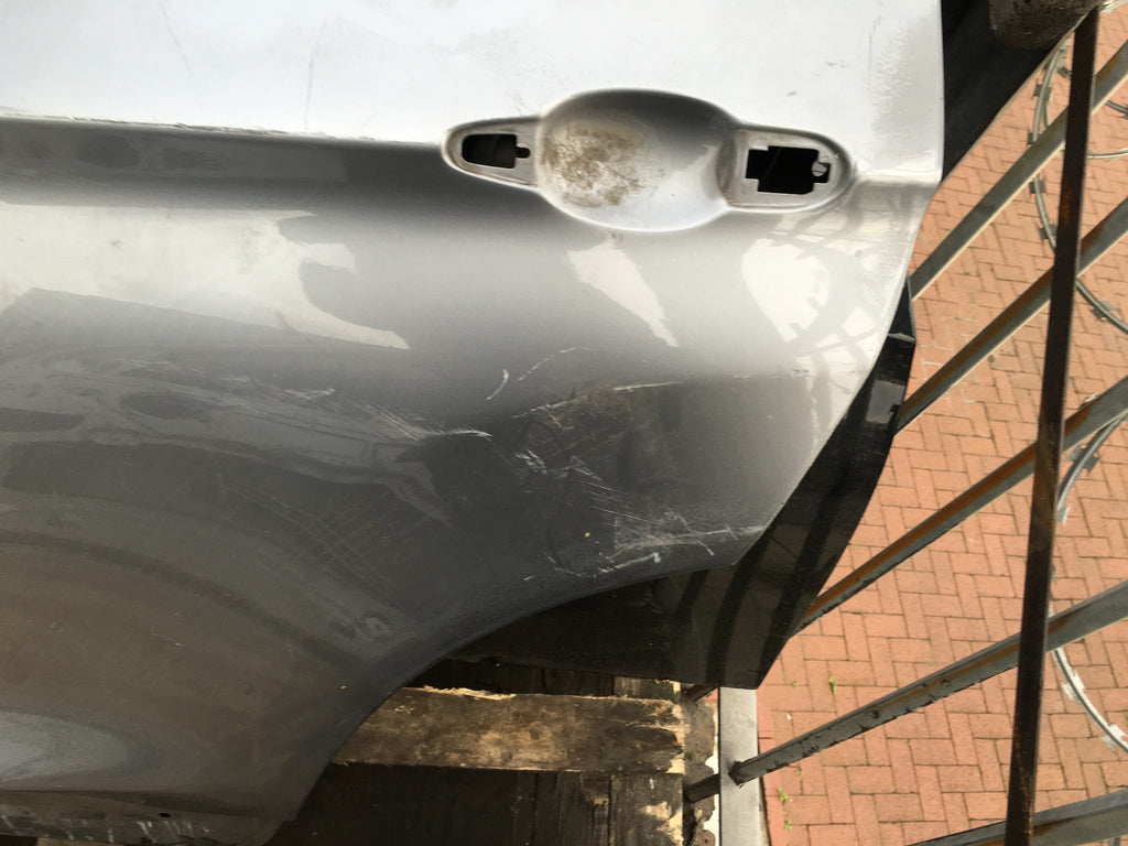 BMW X3 PASSENGER SIDE DOOR SHELL IN SILVER NEEDS REPAIR