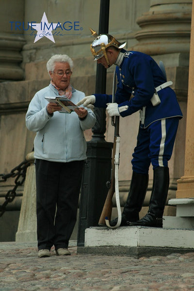 The Royal Guard helping Tourist - The Royal Palace, Stockholm, Sweden