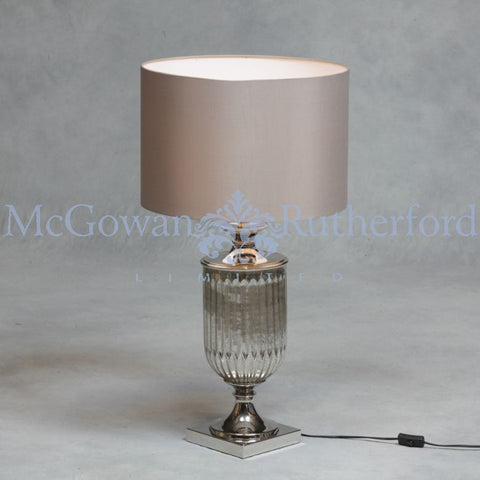 Silvered  glass cylinder lamp with taupe shade
