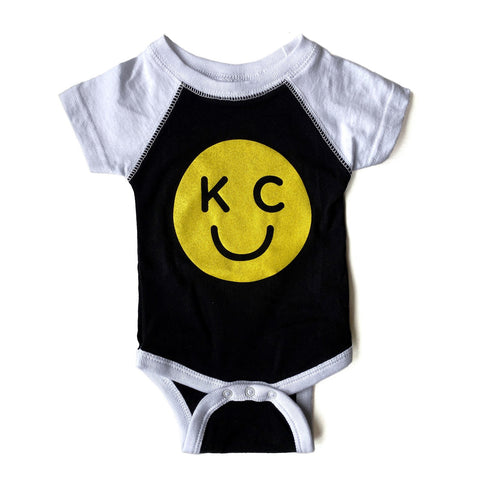 x KIDS | KC SMILEY ONESIE - BLACK