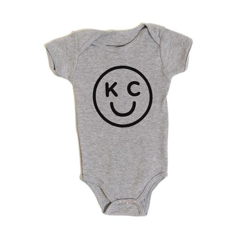 x KIDS | KC SMILEY ONESIE