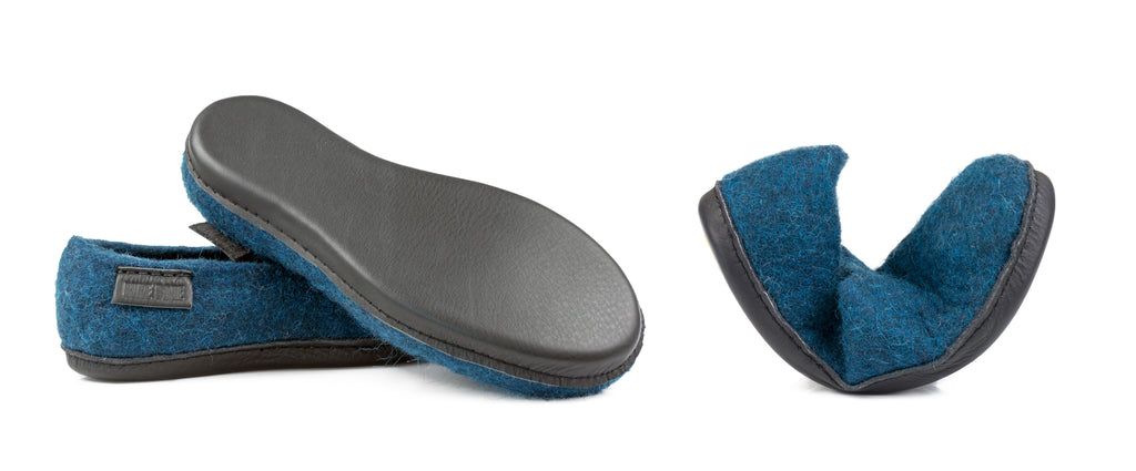 Hand-stitched cork and leather sole on the bottom of the felted wool slippers