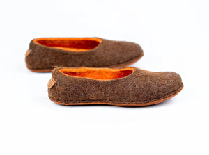 Beige/Orange felted wool slippers that were decorated with alpaca wool