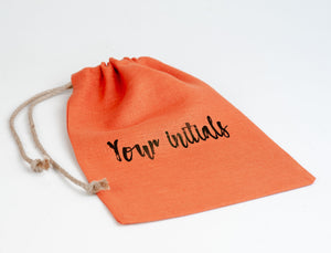 Personalized handmade linen bag with lacing tied up