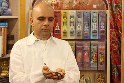Rakesh Samani of Aum Namaste Bookshop burning Prabhuji's Gifts white sage