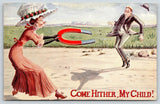 Aggressive Spinster Uses Magnet on Bachelor~Merry Widow Hat~Come Hither~1912 PC
