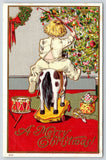 Christmas~Boy in Pajamas Rides New Horse Toy~Decorated Tree~Gold Red Embossed