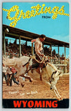 Wyoming~Large Letter Rope Cowboy Greetings~Bucking Bronco~Rodeo~1960s Postcard