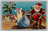 Christmas~Santa in Desk Chair on Candlestick Telephone~Toys in Bag~Silver AMP