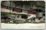 Mellen Wisconsin~Railroad Water Tower~Loaded Boxcars~Neighborhood 1910 Postcard