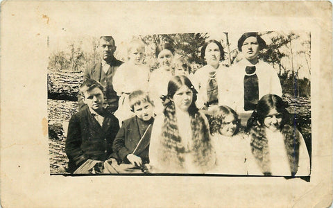 Real Photo Postcard~Family by Fallen Tree~Daughters Have Long Wavy Braids~c1913 | Refried Jeans Postcards