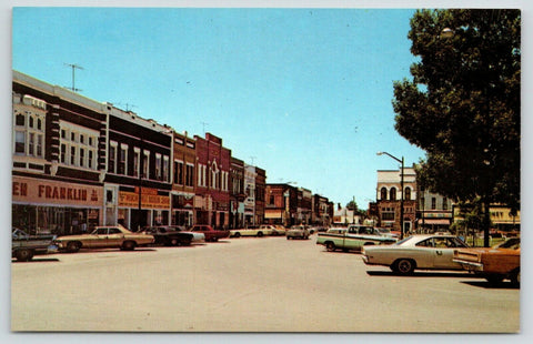 Red Oak Iowa~Main Street~South Side Square~Ben Franklin Store~Wards~1960s Cars