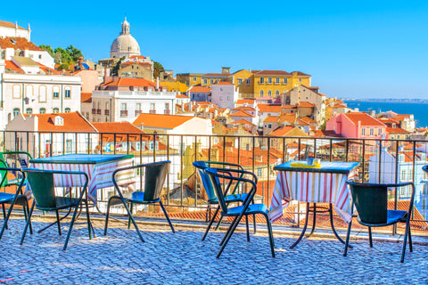 Outdoor cafe with beautiful view over Lisbon and the ocean