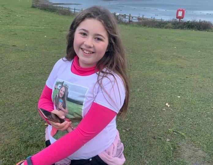 Ten-year-old with painful spine condition walks ten miles for vet charity