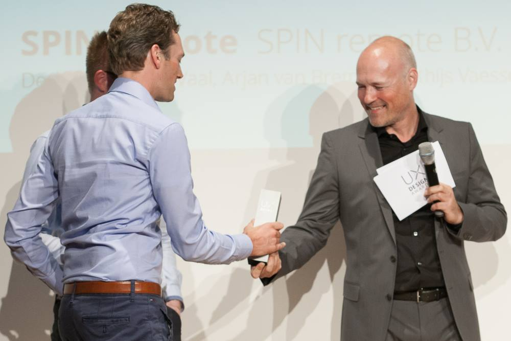 The SPIN remote team, receiving the UX Design Award 2015 from Peter Wouda - Design Director, Volkswagen