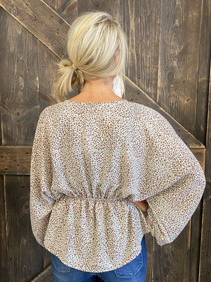 Animal Print Peplum Top with Bubble Sleeves