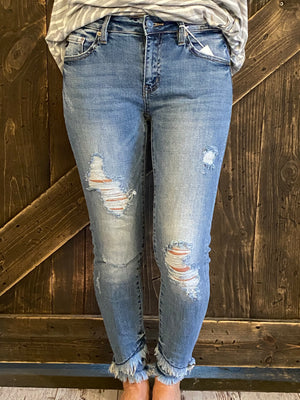 Distressed Denim with Raw Asymmetrical Hem