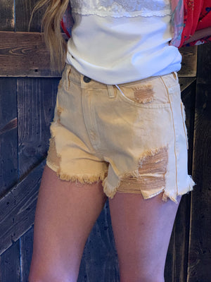 Distressed High Rise Shorts with Raw Hem in Mustard