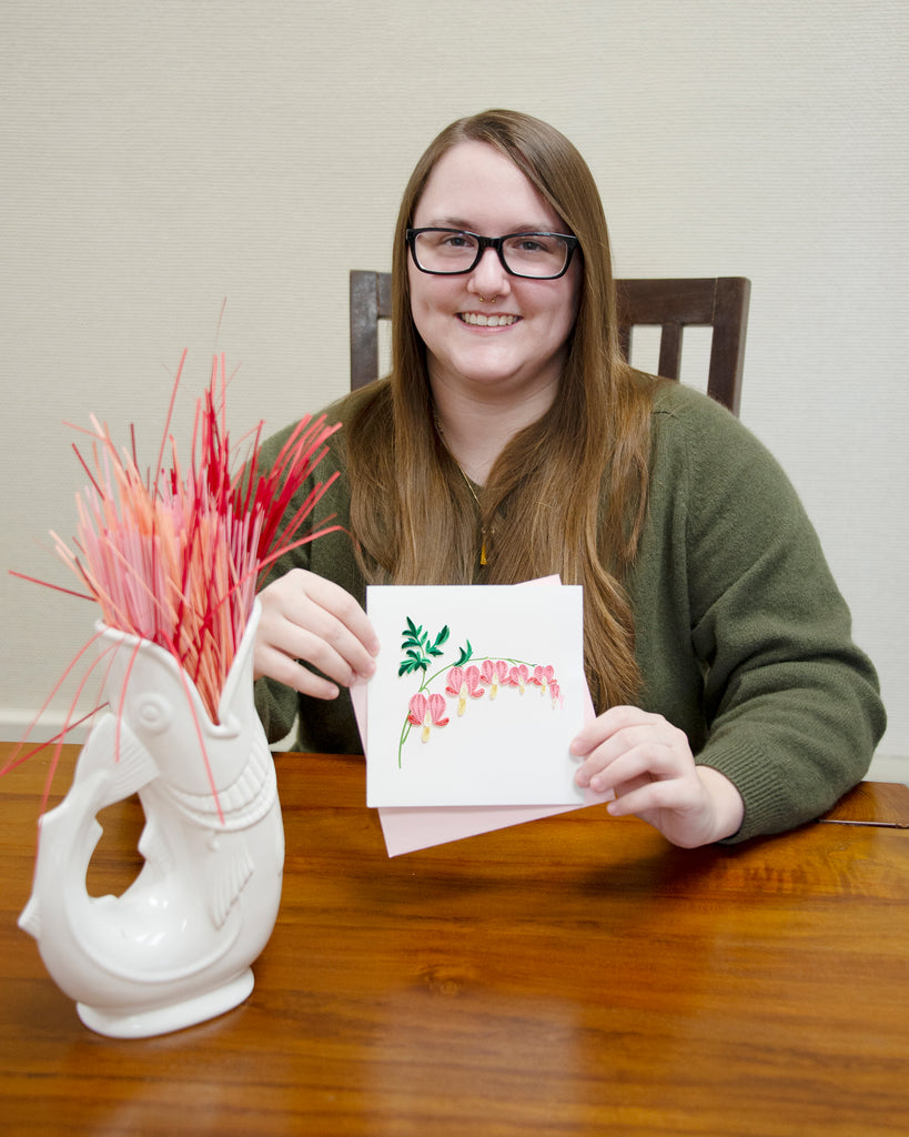 Woman holding the Quilled Bleeding Heart Greeting Card