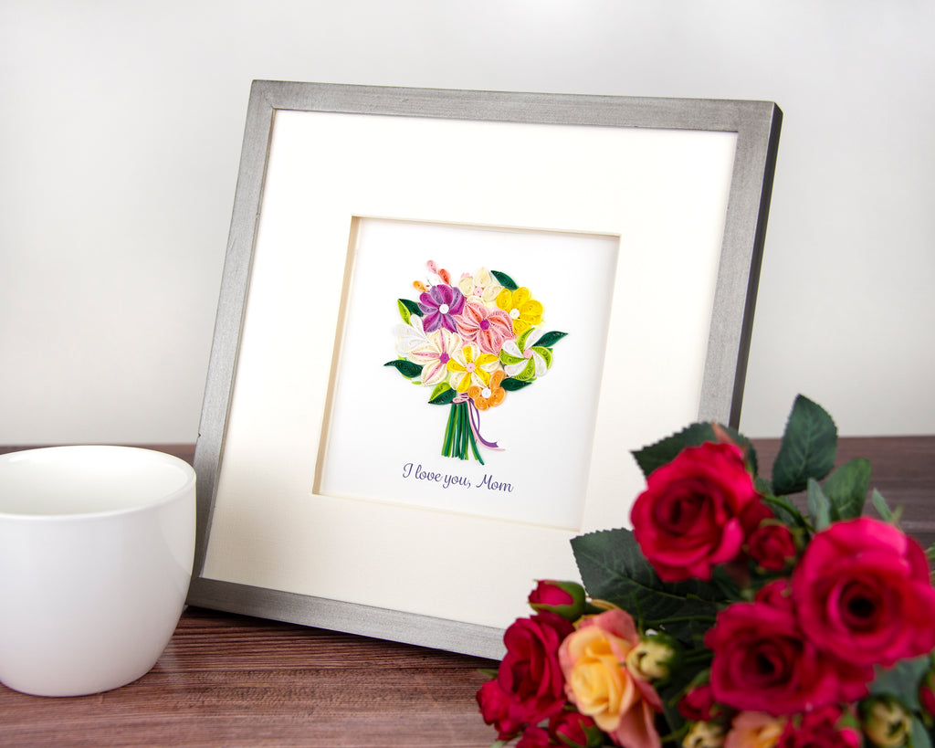 A framed Mother's Day card on display