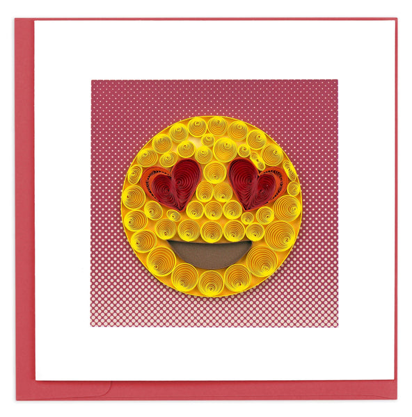 An emoji with a classic yellow face and heart shaped eyes.