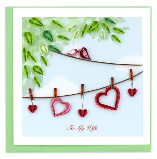 Valentine's Day card featuring a quilled design of two birds sitting on a clothesline and hearts hanging below