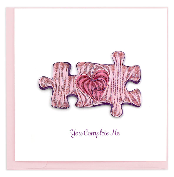 Valentine's Day card featuring a quilled design of two puzzle pieces together which make a heart