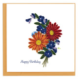A bunch of colorful flowers in red, orange and blue colors, and includes the message Happy Birthday.
