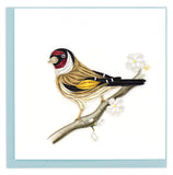 Blank Quilled Card of a brown, black, yellow and red bird perched on a branch with white flowers.