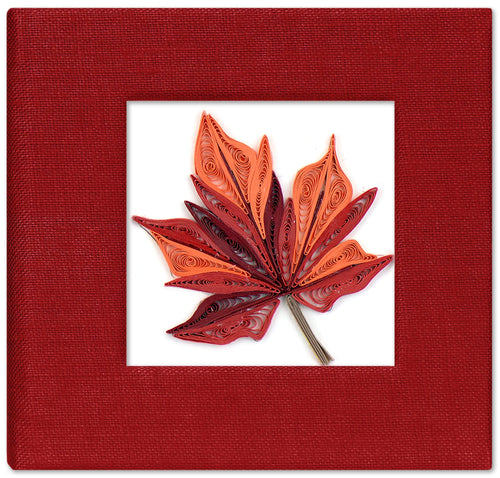 Sticky note pad cover featuring a quilled design of a maple leaf